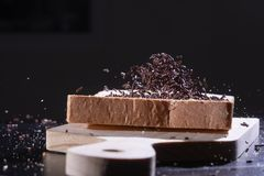 Chocolate sprinkled on sliced bread royalty free stock photo