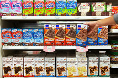 Chocolate Sprinkles. THE NETHERLANDS - SEPTEMBER 2016: Shelves filled with Chocolate Hagelslag packings in a Dutch Poiesz Supermarket. In The Netherlands royalty free stock photography
