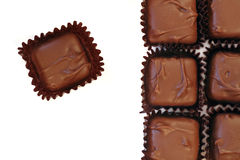 Chocolate squares. Over white, close up stock photography