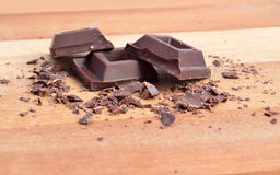 Chocolate squares. And crumbles on wood surface Stock Images