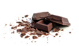 Chocolate squares. And crumbles on white background Stock Photo
