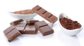 Chocolate squares and cocoa powder Stock Photos
