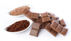 Chocolate squares and cocoa powder Royalty Free Stock Image