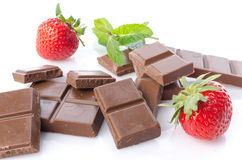 Chocolate squares with fresh mint and strawberries Stock Photography