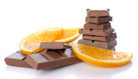 Chocolate squares with fresh orange slices Stock Image