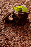 Chocolate. Stack of chocolate pieces and leaf of mint stock image