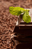 Chocolate. Stack of chocolate pieces and leaf of mint Stock Images