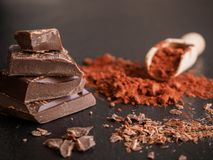 Dark chocolate with cocoa on a dark background stock photography