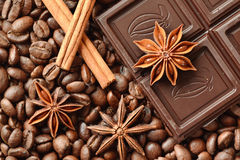 Chocolate, star anise and cinnamon on coffee beans Royalty Free Stock Images