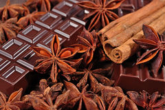 Chocolate, star anise and cinnamon sticks close up as Royalty Free Stock Image