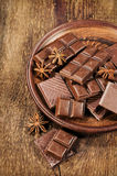 Chocolate and star anise in a clay plate Stock Photos