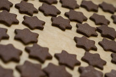 Chocolate star cookies on sheet one missing Stock Photography