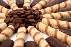 Chocolate sticks with a cream and the grains of coffee Royalty Free Stock Images