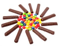 Chocolate sticks with a cream and the multi-coloured sweets isol Royalty Free Stock Photos