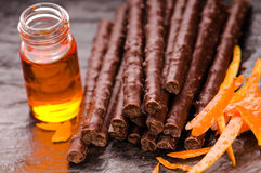 Chocolate sticks with orange Stock Photo