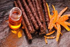 Chocolate sticks with orange Stock Photos