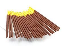 Chocolate sticks on a saucer Stock Image