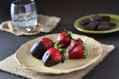 Chocolate strawberries on dark background Royalty Free Stock Images