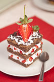 Chocolate strawberry cake with whipped cream Royalty Free Stock Photography