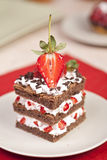 Chocolate strawberry cake with whipped cream Stock Photo
