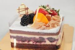 Chocolate strawberry cake on white background. Royalty Free Stock Photo