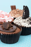 Chocolate Strawberry Cookies and cream cup cake on vintage table cloth. Chocolate Strawberry Cookies and cream cup cake on vintage blue table cloth Royalty Free Stock Images