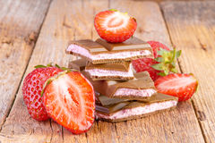 Chocolate with strawberry cream on wood Stock Photography