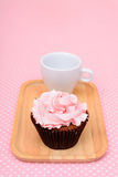 Chocolate Strawberry cup cake. On vintage pink table cloth Stock Images