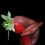 Chocolate strawberry delight. Fresh strawberry coated in smooth milk chocolate sauce Royalty Free Stock Images
