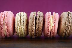 Chocolate, strawberry and vanilla macaroons. Royalty Free Stock Photo