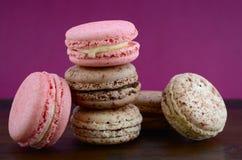 Chocolate, strawberry and vanilla macaroons. Stock Photography