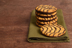 Chocolate stripe cookies on green napkin Stock Photos