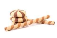 Chocolate striped wafer rolls and stake biscuits. Royalty Free Stock Photography
