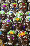 Chocolate and sugar made skulls candy with colored eyes Royalty Free Stock Photography