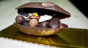 CHOCOLATE SUPRISE. A chocolate egg filled with various small and different types of chocolate sweets Stock Photos