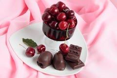Chocolate and sweet cherry. Chocolates and sweet cherry berries Royalty Free Stock Photo