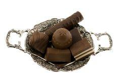 Chocolate sweet on saucer Stock Image