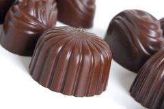 Chocolate sweets. On a white background Royalty Free Stock Photos