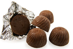 Chocolate sweets. And one of it in foil Stock Images