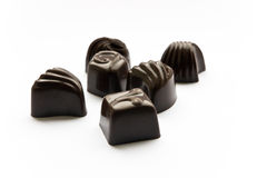 Chocolate sweets. Some chocolate sweets on a white background Royalty Free Stock Photo