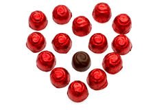 Chocolate sweets. Arranged as a heart over white background royalty free stock photography