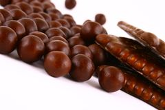 Chocolate sweets against white Stock Images