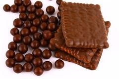 Chocolate sweets against white Stock Photo