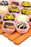 Chocolate sweets on the bamboo mat Stock Images