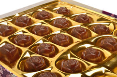 Chocolate sweets in the box on white Royalty Free Stock Photo