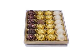 Chocolate sweets in the box on the white background. Royalty Free Stock Images
