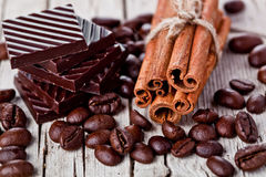 Chocolate sweets, cinnamon and coffee beans Stock Image