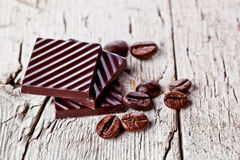 Chocolate sweets and coffee beans Royalty Free Stock Image