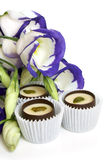Chocolate sweets with flowers (lisianthus) Royalty Free Stock Photography