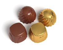 Chocolate sweets with golden wrapper. Dark chocolate sweets with golden wrapper Royalty Free Stock Image